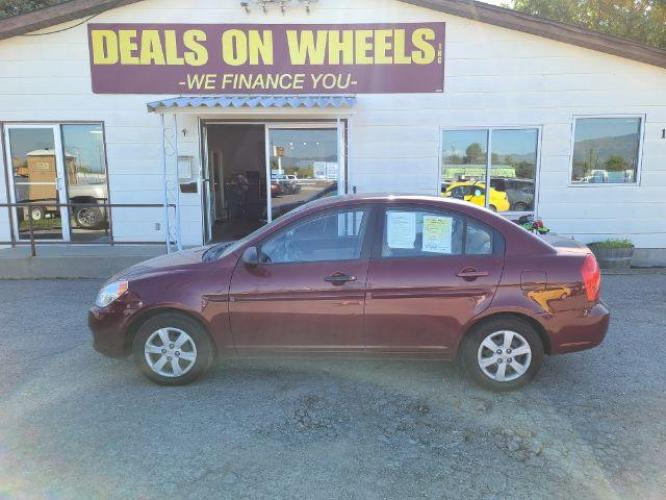 2009 Hyundai Accent GLS 4-Door (KMHCN46C59U) with an 1.6L L4 DOHC 16V engine, located at 1821 N Montana Ave, Helena, MT, 59601, (406) 543-1986, 46.603153, -112.020531 - Photo #0