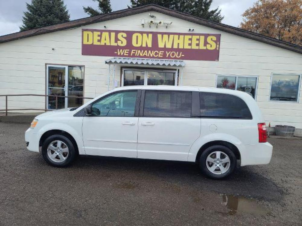 2009 Dodge Grand Caravan SE (2D8HN44E49R) with an 3.3L V6 OHV 12V engine, 4-Speed Automatic transmission, located at 1821 N Montana Ave, Helena, MT, 59601, (406) 543-1986, 46.603153, -112.020531 - Photo #0